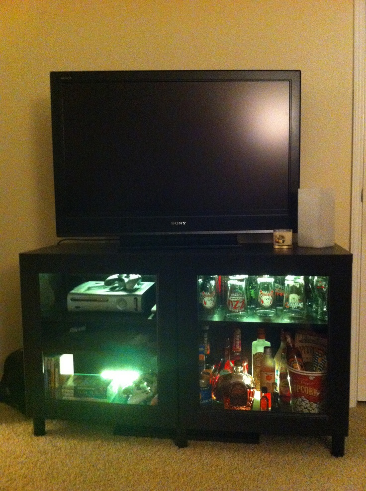 man cave mini bar. Easy man cave idea  IKEA or other inexpensive shelving unit add glass doors drawers color changing LED lights and fill with mini bar essentials