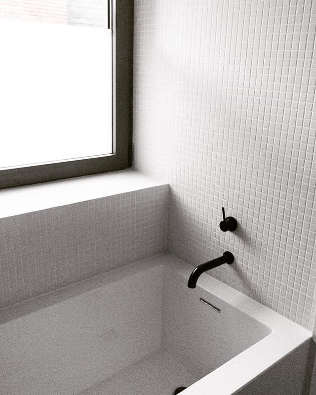 Black meets white in this Contemporary mosaic tile bath. Photo by @doubledeezy.