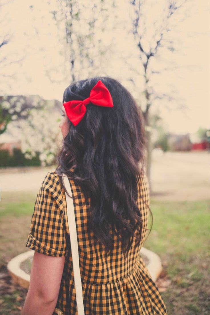 With a bow in her hair