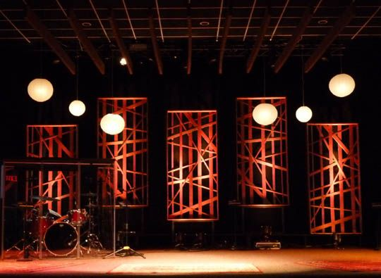 a warm welcoming stage design featuring woven wood panels and hanging paper lanterns more stage design ideas ms - Church Design Ideas
