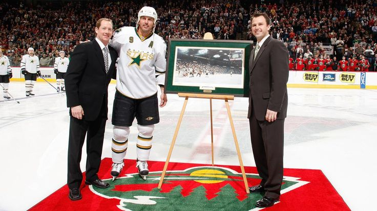Mike Modano of the Dallas Stars is awarded with a photograph for becoming the All Time U.S. Born Scoring Leader.