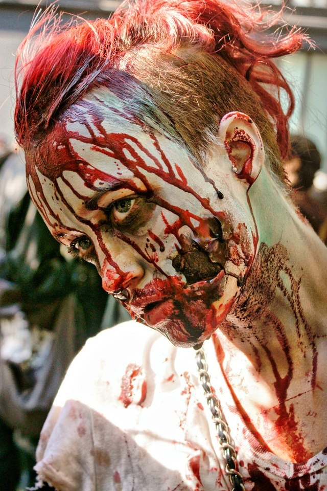 halloween zombie makeup -- this would be relatively simple to do with makeup and some liquid latex and a hell of a lot of fake blood