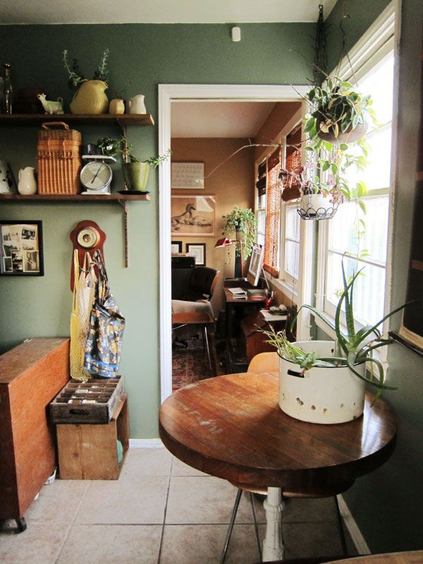 love the furniture and plants, wall colour and stony tiles