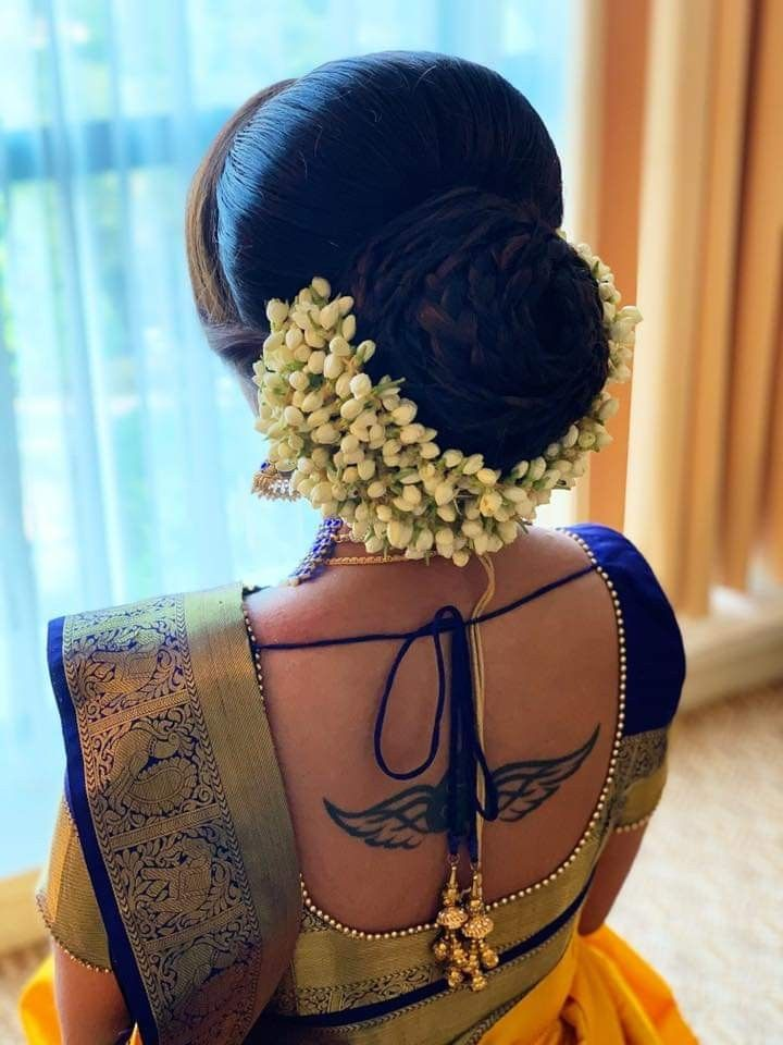 What A Beautiful Large Low Bun With Real Flower Gajra Care However Should Be Taken Before Adopting Such Low Bun Wedding Hair Saree Hairstyles Bridal Hair Buns