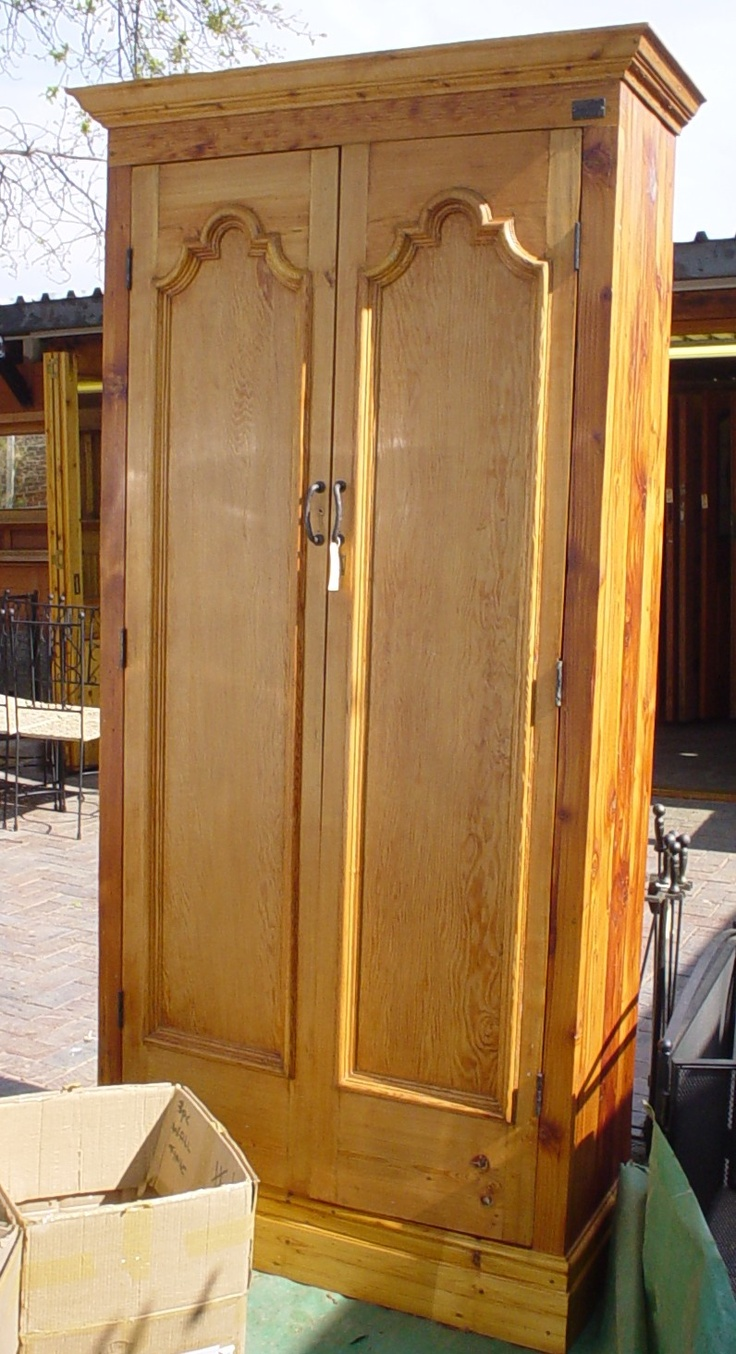 Doors salvaged from a home that was demolished for the Gautrain - Orejen turned it into a cupboard.