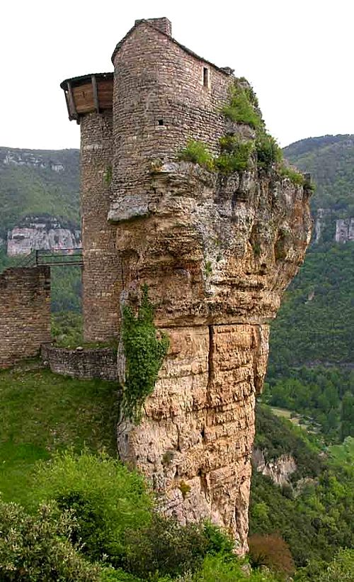 """Château Fort de Peyrelade in Rivière-sur-Tarn, Aveyron, France  http://www.castlesandmanorhouses.com/photos.htm  Thanks to its position controlling the entrance to the Gorges du Tarn, it was one of the most important castles in the Rouergue province  The name is derived from the occitan """"Pèira Lada"""", meaning wide rock  Objects found on the site suggest it was inhabited in prehistoric times."""