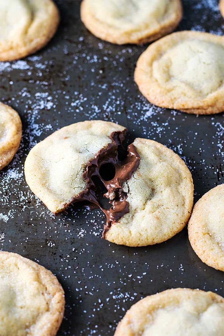 Old fashioned soft and chewy sugar cookies stuffed with creamy Nutella. Trust me, this combination is as delicious as it sounds!