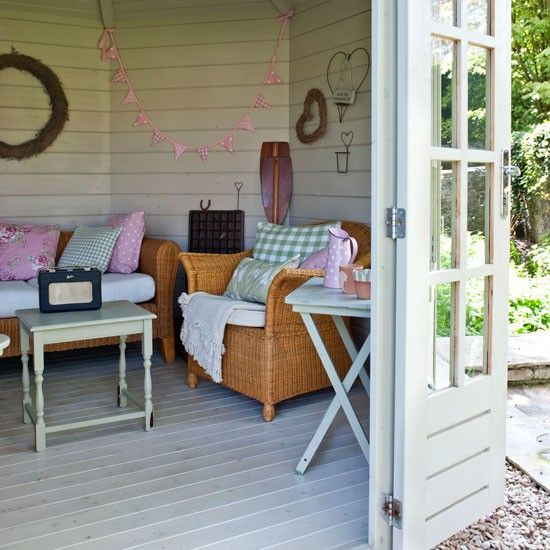 Give a summerhouse a relaxed look with a mix of painted and natural wicker garden furniture. Junk-shop finds, such as a folding tray table and occasional table, look chic when repainted in a subtle shade.