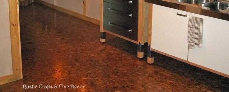 Our Finished OSB Flooring  - I would only go for this with super dark stain.  Don't think light or white washing would work very well.