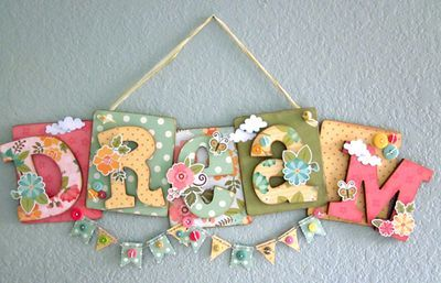 This is totally doable to make- you could use coasters for the back, and chipboard letters instead of wood letters like she used....