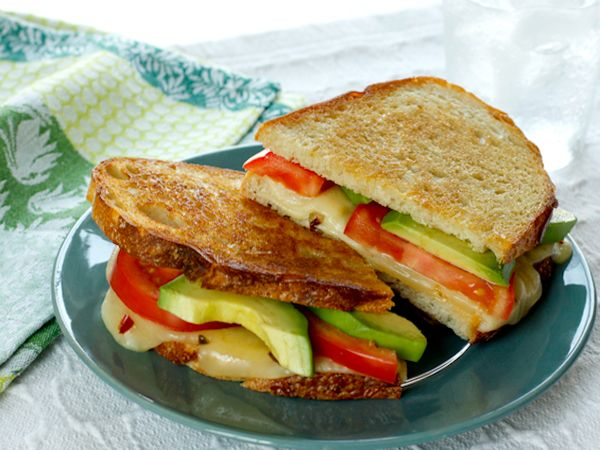 Featuring plenty of salted butter and delicious Cabot Pepper Jack Cheese, our classic avocado tomato grilled cheese is an incredibly tasty dish, and it's sure to be a winner in your home. Our recipe makes two servings, and is quite easy to prepare. It features plenty of healthy ingredients, such as vine-ripened tomatoes and avocado, but it also features some of our popular pepper jack cheese and salted butter to really crank up the flavor factor. We suggest making this sandwich for lunch…