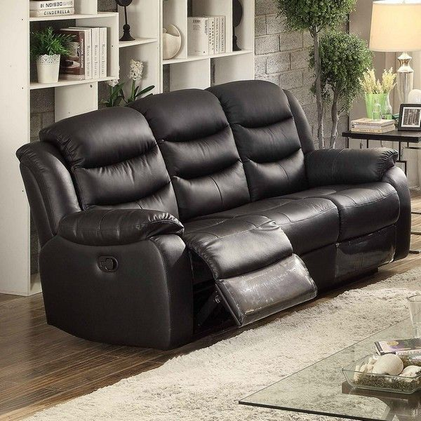 Bennett Transitional Glider Reclining Sofa. The Bennett sofa offers dual recliners with plush cushioning and ample proportions that make for ultra-comfortable seating. This showcases clean, modern lines and padded arms. It is covered in a black leather match fabric. The contemporary design, generous seating and unique appeal emphasize proportion and functionality. It also features plastic covered foot rest for added protection. Enjoy for years to come.Simple, yet stylish glider reclining...