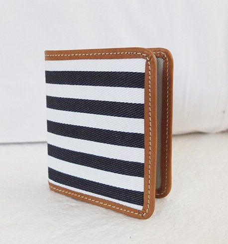 Weight : 90 g Material : canvas with real leather Size: 10.5h X 8w cm   Card holder with 20 plastic sheets