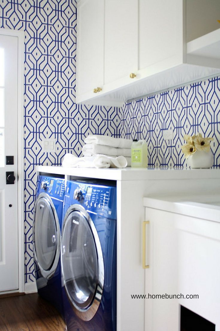 Bold wallpaper in a custom laundry room cabinet design - Innovate Home Org Columbus Ohio