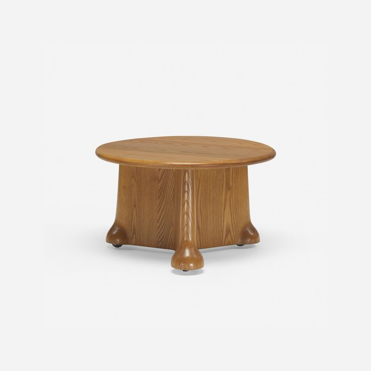 Lot 284: Wendell Castle. Quinn coffee table. 1976, carved oak, casters. 27¾ dia x 16½ h in. estimate: $10,000–15,000. Provenance: Gannett Company, Inc. Rochester, NY | John Quinn, Cocoa Beach, FL | Thence by descent