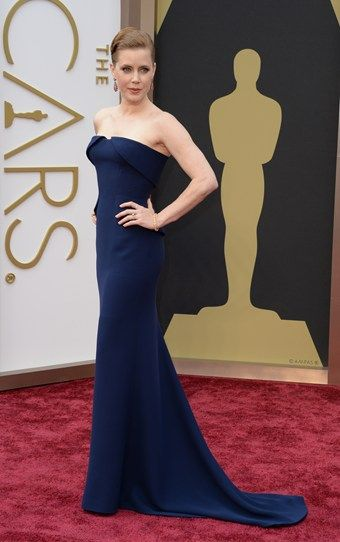 Best actress nominee Amy Adams plays it safe in navy, but the way the dress fits her shape to perfection saves the look from being boring. #Oscars