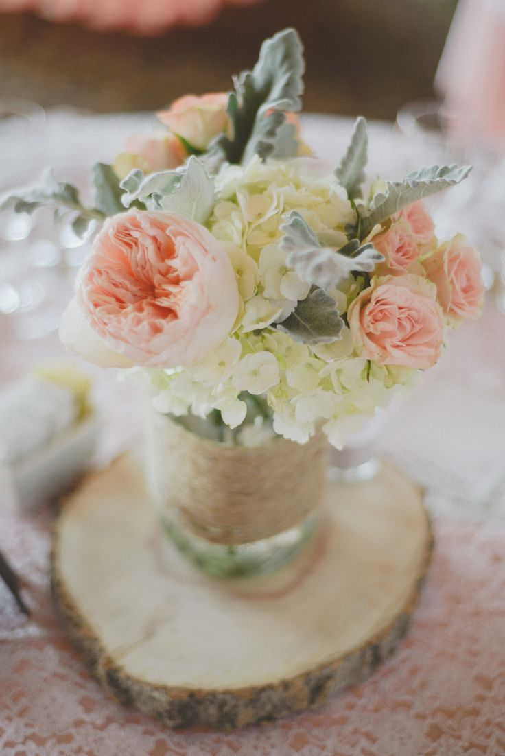cute peach and white mason jar arrangement with dusty miller  Photography: Sugar And Soul Photography - sugarandsoulphotography.com