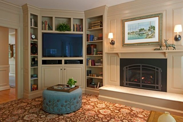 Transitional Family Room Design with Corner TV Cabinet and Bookcase beside Fireplace with Blue Ottoman Ideas