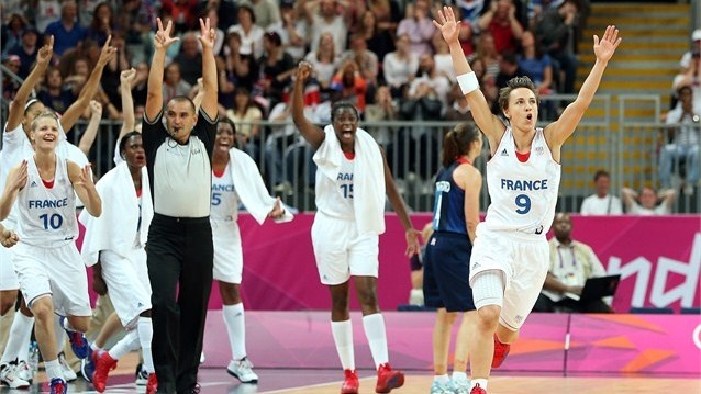 Celine Dumerc of France celebrates after hitting a three pointer with just seconds to go in the women's Basketball preliminary round match against Great Britain on Day 7 of the London 2012 Olympic Games at Basketball Arena.