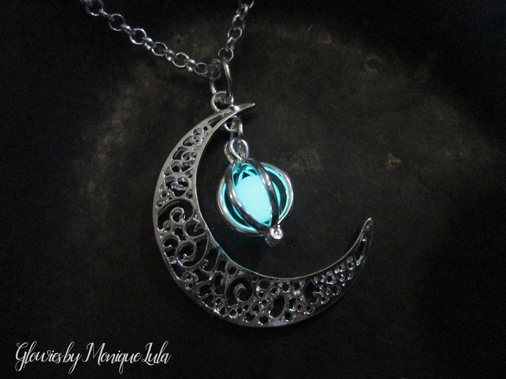 """Crescent moon with matching silver plated glowing orb cage with glow glass. Handmade in smoke free studio. The original Glow Lockets ® handmade by Monique Lula. One of my original designs inspired by the glowing magical orbs and the moon. Just wear in sunlight, will glow in the dark. Moon measures 1.5 inches and chain is 18"""" hypoallergenic stainless steel. High Quality silver plated copper moon and cage pendant. The glow orb is the finest glass glow in the dark, super bright. NEW AND IMP..."""
