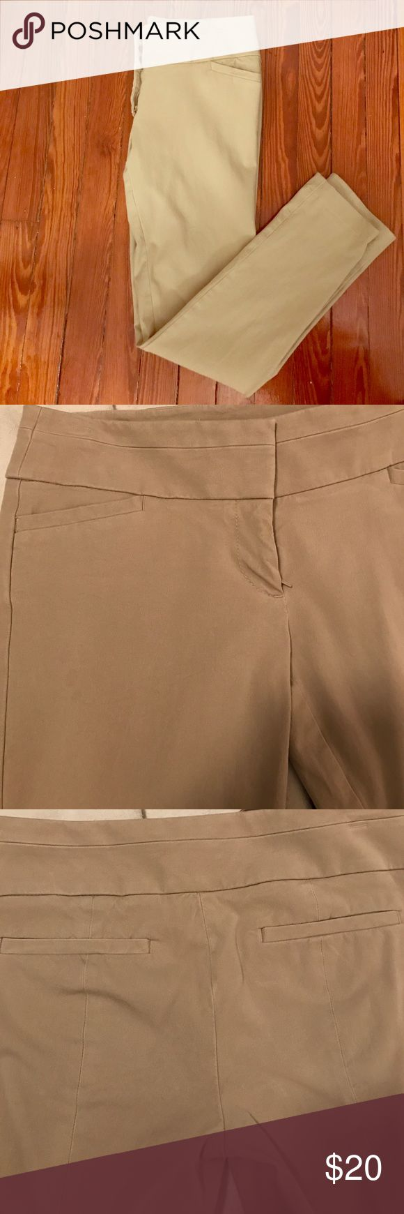 The Loft Marisa Skinny khaki pants. The Loft Marisa Skinny pants in khaki. Super cute for an office environment. Hem has been let out (pictures attached & I'm 5'5 for reference) but can easily be taken back in. Barely worn. LOFT Pants Skinny