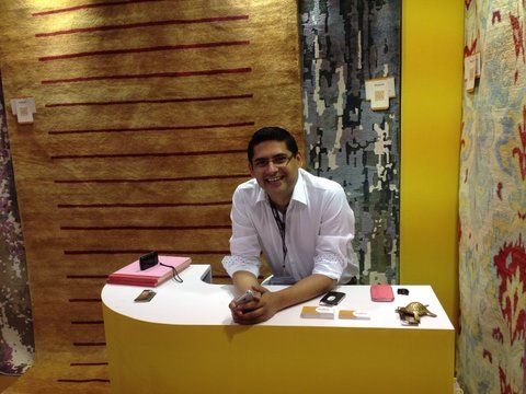 HMW Founder Mr. Adarsh Mishra at an event - behind his beloved rugs!  We just love all things handmade be they rugs, home accessories or home furnishings!