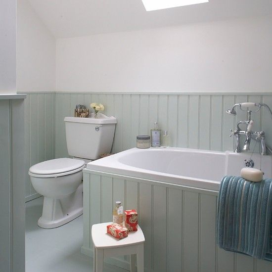With its simple white sanitaryware and soft aqua tongue-and-groove panelling, this bathroom has a sanctuary-like feel thats makes it the perfect place to relax in.