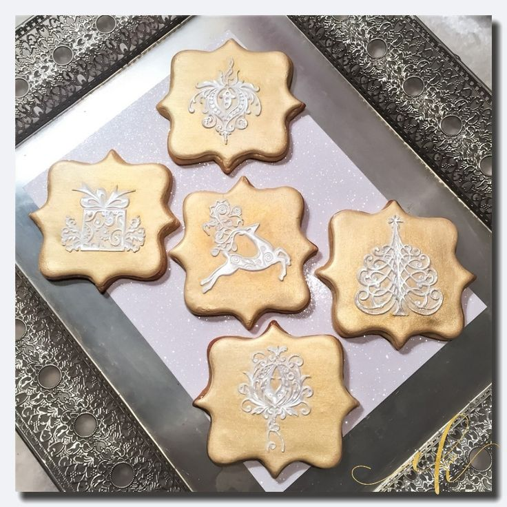Christmas Cookies dressed in royal icing and decorated with edible lace!