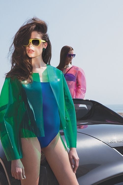 Just rollin' around a luxurious car in a bathing suit and green moto jacket. NBD!