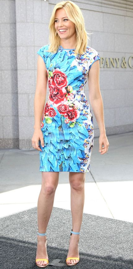For an appearance on Extra, Elizabeth Banks color-coordinated her bright McQ Alexander McQueen bodycon dress with Sophia Webster sandals. She accessorized with Melinda Maria earrings and an EF Collection ring. #InStyle