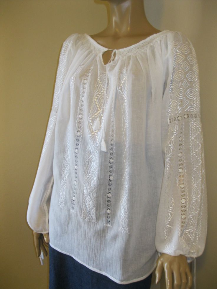 Delicate hand embroidered and hand sewn Romanian  peasant blouse with WHITE silk thread  on white gauze cotton. An exquisite peasant blouse you cant miss out !  At www.greatblouses.com