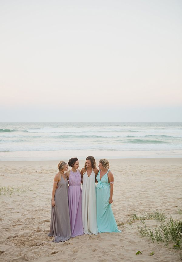The bridesmaids wore floaty dresses in soft, watery shades of aqua and amethyst. | Photo by Just for Love Photography