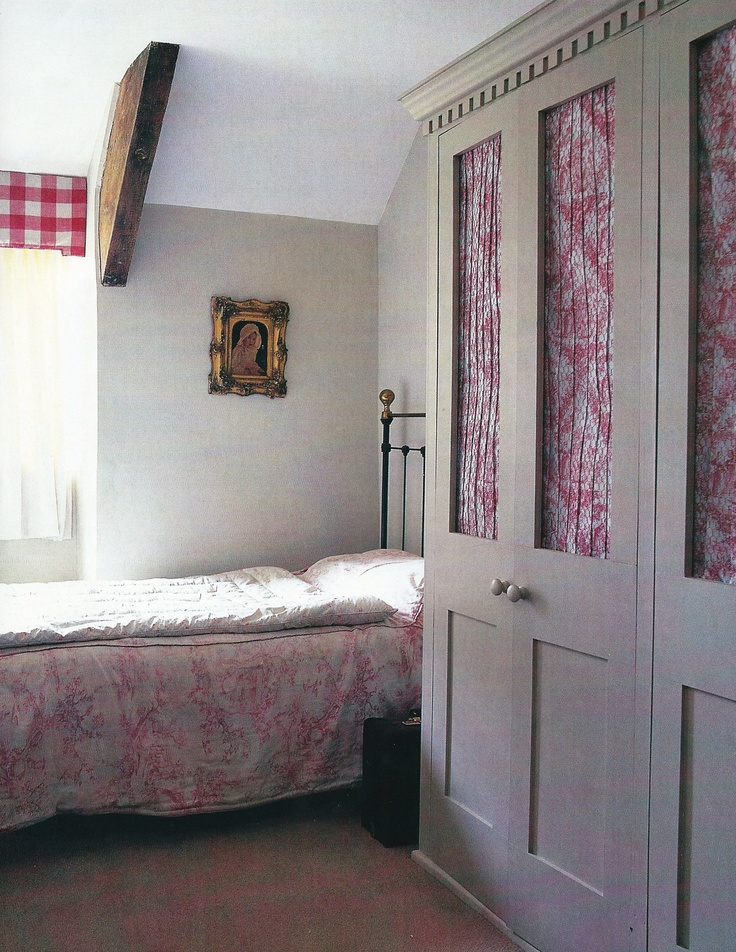 Love the built in wardrobes with toile curtains. This would be a good idea for storage in an attic bedroom.