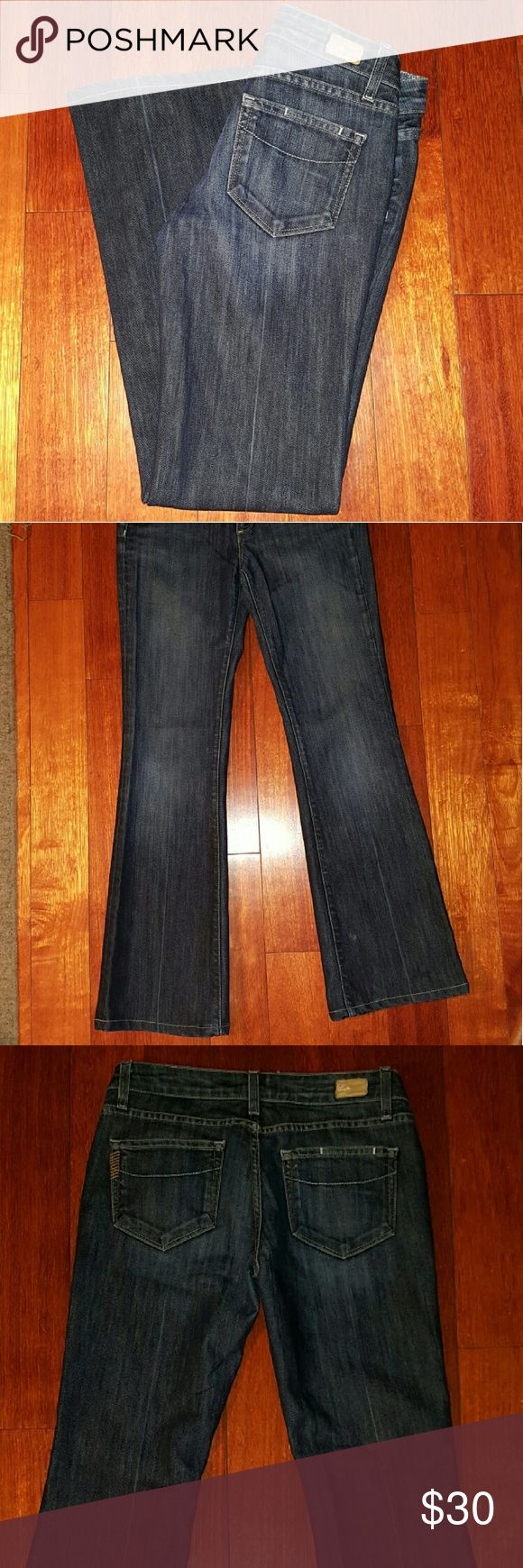 Paige premium denim jeans Paige Laurel Canyon low-rise boot cut jeans.  Great condition except for the faded crease line done center of leg.  Shown in photos.  Lots of life left.  Beautiful worn look.  Inseam 30 60% cotton/40% polyester Paige Jeans Jeans Boot Cut