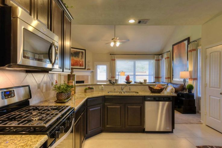 You'll never cook alone in this kitchen open to a great room. A new home built by Legend Homes in the Lone Trail Village community. Texas City, TX.