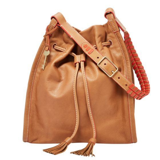 Festive in fringe—Claire's desert-themed satchel features a simple silhouette with woven drawstring details and an adjustable strap in soft nubuck.*Will be shipped separately from other products