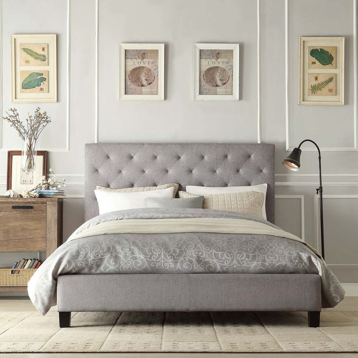 This elegant platform bed features a button-tufted headboard and durable linen upholstery. This queen-sized bed has small black wooden legs to raise it off the floor.