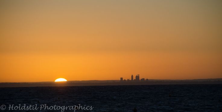 Nikon D5100 Auto mode no flash. 1/1000sec exposure f/8 Focal length 140mm ISO 160 (Auto) Lens 55-300mm. Sunrise over Perth