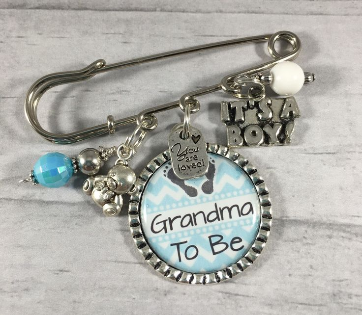 *****This listing is for ONE Pin.****** Includes a FREE key ring to make into a key chain. Pendant can also be placed on a necklace. These adorable pins make great gifts for the Mommy, Grandma, Aunt, Nana, Great-Grandma, or Sister To Be. If you have a special name for your loved one these can be personalized to fit you. These designs come in several different colors. Please leave choice of Color and Personalization at Checkout.  There are other designs and colors available in my shop in the…