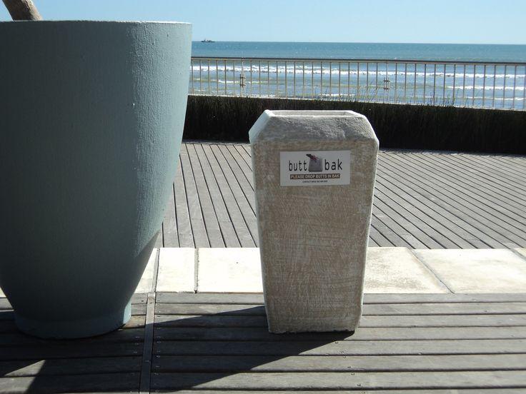 Butt Bak Outdoor Ashtray on restaurant deck at Lagoon Beach Hotel Cape Town. Stone colour