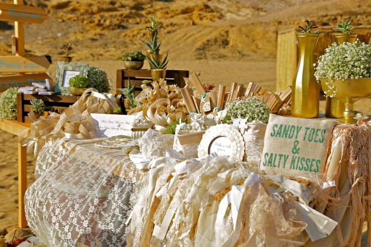 The bohemian chic welcome table with wild flowers, cactus compositions, lace and wooden details!