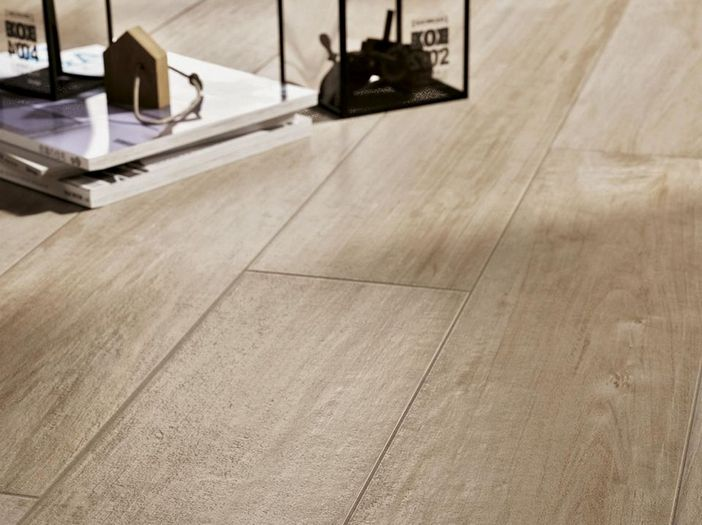 Woodcomfort is a affordable soft edge porcelain floor tile.