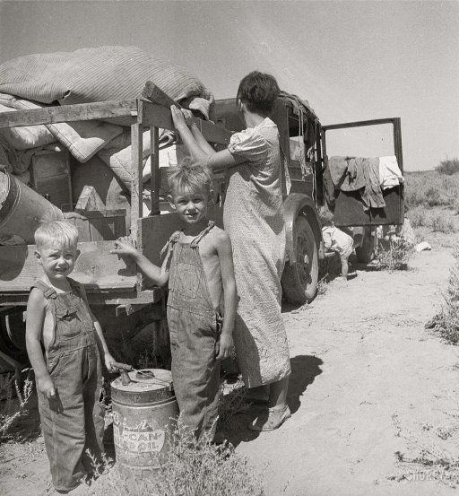 1936 - Impoverished family of 9 from Iowa, on a New Mexico highway.They were about to sell their belongings to buy food.