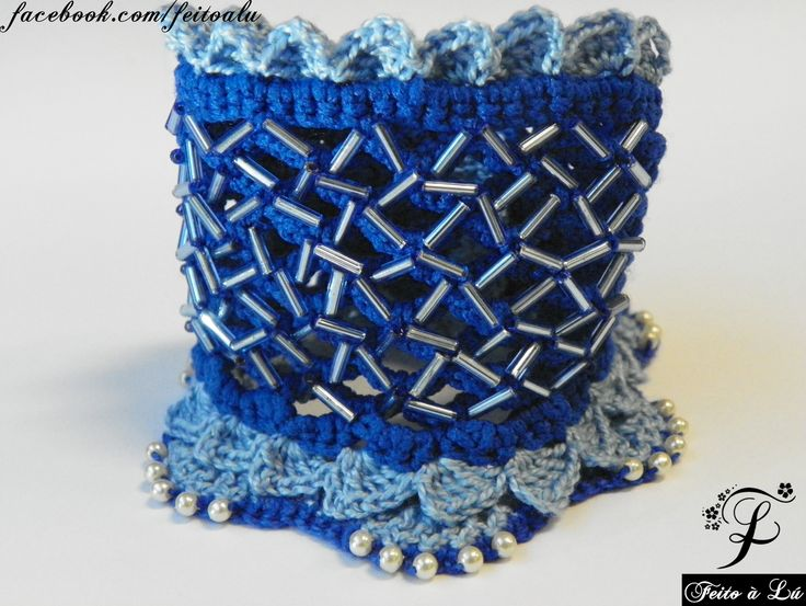 Crochet Jewelry - Ocean  Crochet cuff, decorated with blue bugle beads and white pearl. The colors are blue sapphire and azure. This Crochet Jewelry was made with high quality and resistant colors line.  The distance from the button to its hole is 16cm.  #crochet #crochetjewelry #crocheting #bracelete #bangle #bracelet #fashion #beadedbracelets #crochetcuff #crochetbeadework #crochetroses #crochetflowers