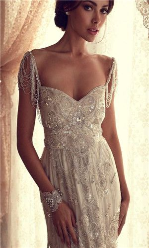 wedding dress...so flapper style, the bead work is amazing in this dress and I could TOTALLY see you wearing this too.  The arms part hangs at just the right level too that makes it flattering