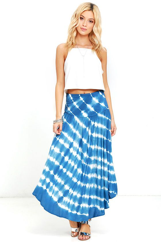 You'll be cool and casual in the Piece by Piece Blue Tie-Dye Midi Skirt! This breezy and beach-y skirt has a high, banded waist (made from knit fabric), and a flowy woven silhouette with twin side slits. Hidden side zipper with clasp.