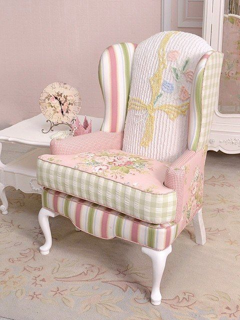 I own a chaIr identical to this piece with 5 varied pieces of fabric also.  Blue & green  plaids to check & floral.  HOWEVER, I love this piece in the PINKS.  Most of all, I adore the VINTAGE CHENILLE BEDSPREAD piece on the back and the painted white legs.   Really adorable!
