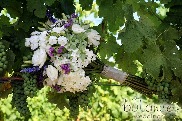June bouquet designed by Local Color Flowers filled with locally grown hydrangeas, statice, lisianthus, gooseneck loosestrife and salvia.
