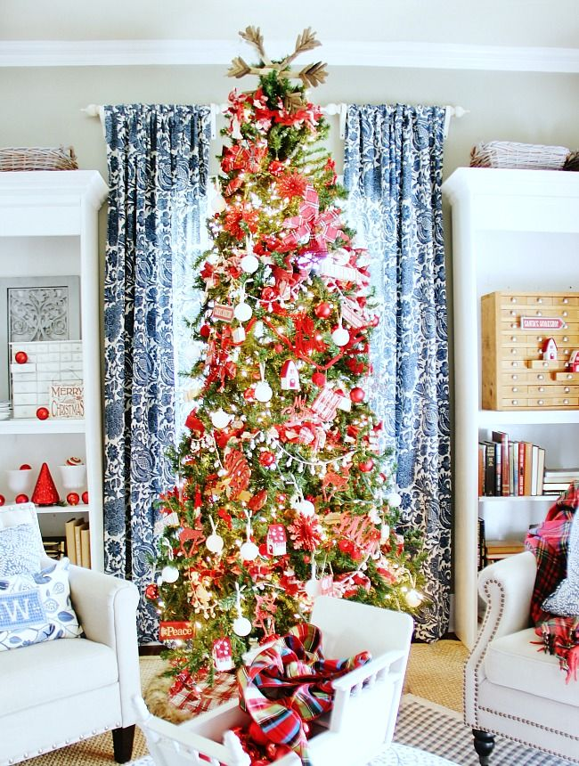 Tree has small, medium and large items on it, plus a variety of shapes and textures (felt, rags, ribbons, metals, wood)