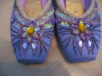 Check out all these hand-decorated pointe shoes. What a great gift for a ballet teacher.